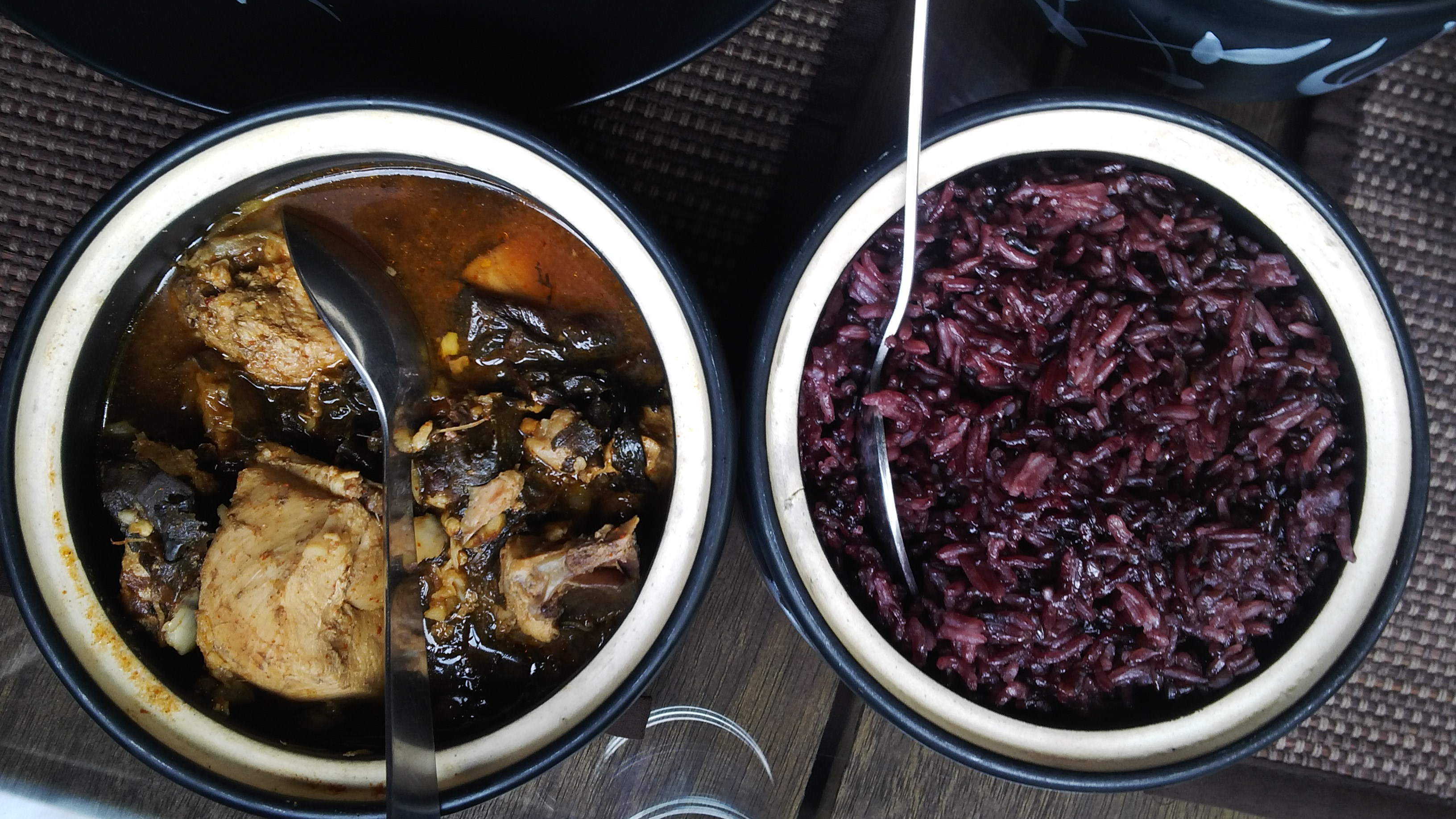 Red rice and chicken in yam leaves