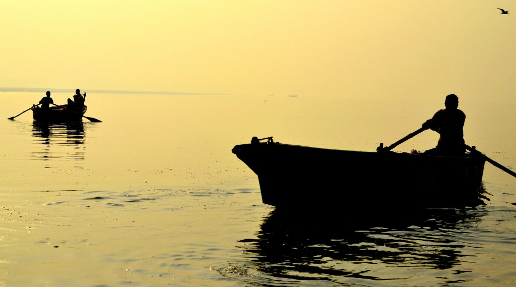 An essential Varanasi experience is a dawn rowing boat ride along the Ganges. (Photo by Mukund Prabhakar)